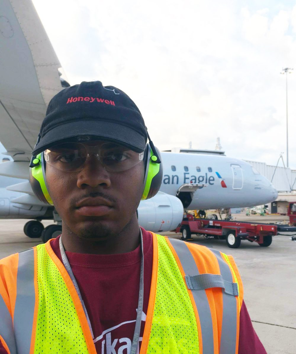 student working at airport