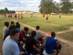 Students watching flag football