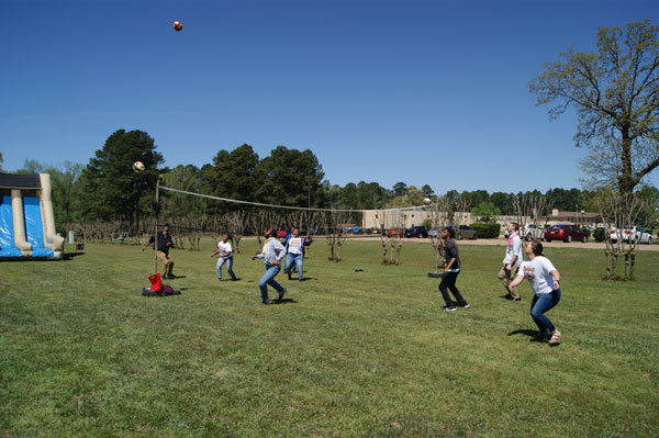 group of students playing volleyball outside