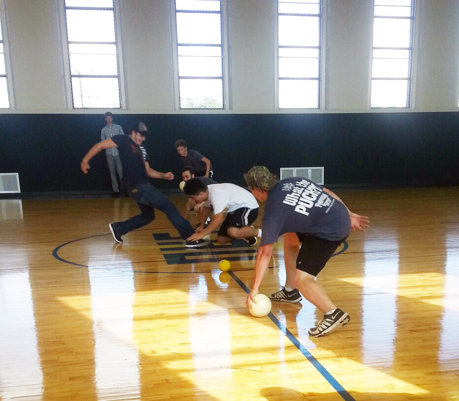 Students playing dodge ball in the gym