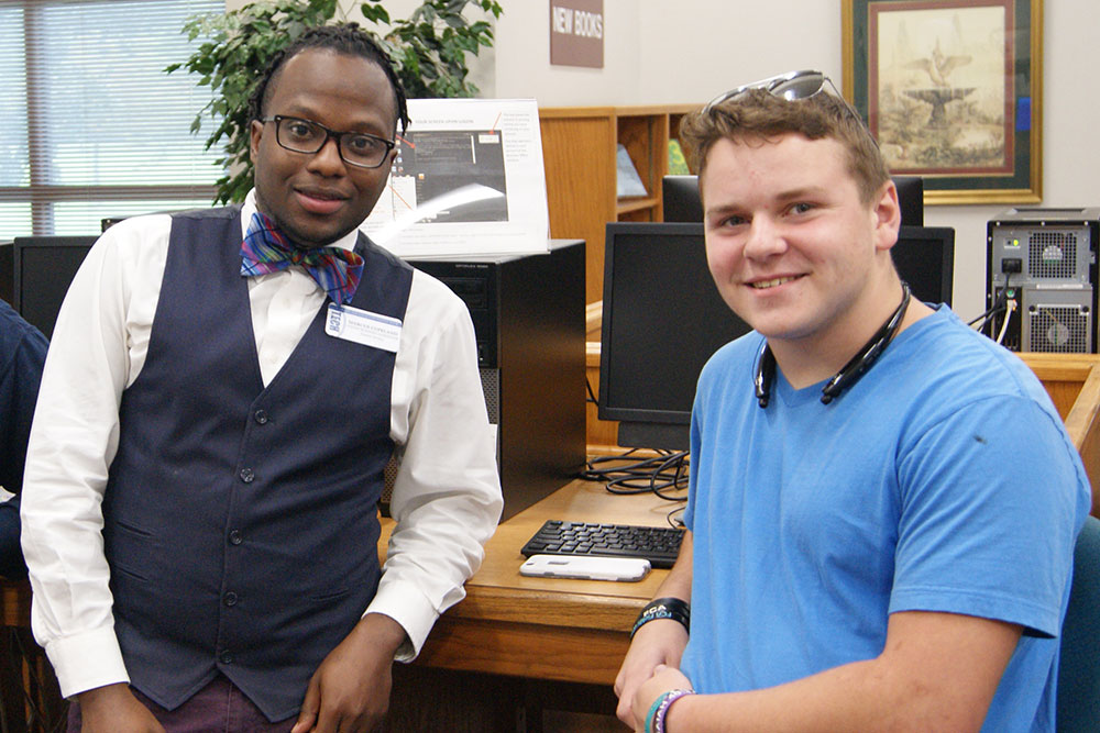 black male and white male smiling