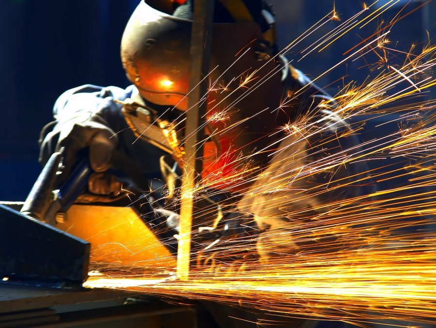 welder welding with sparks flying