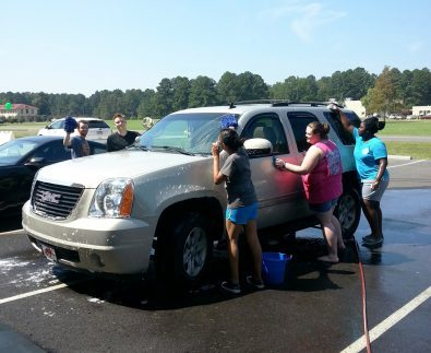 Students washing cars