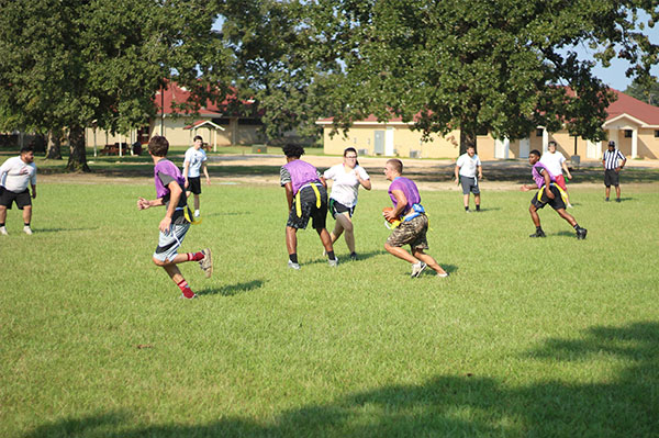 college students playing flag football