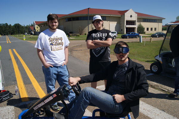 three white males driving go-carts