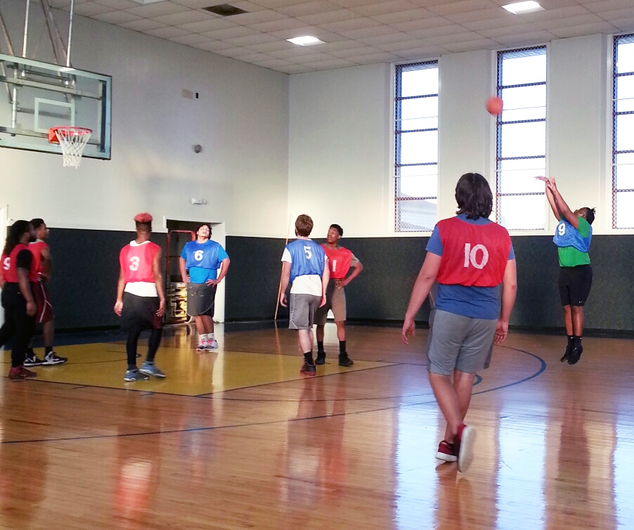 Students playing basketball in the gym