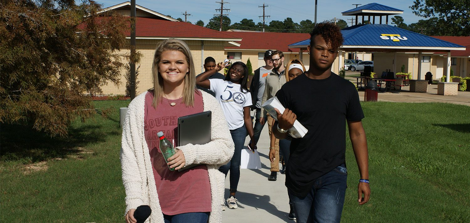 college students walking