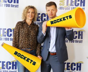 a man and woman holding megaphones