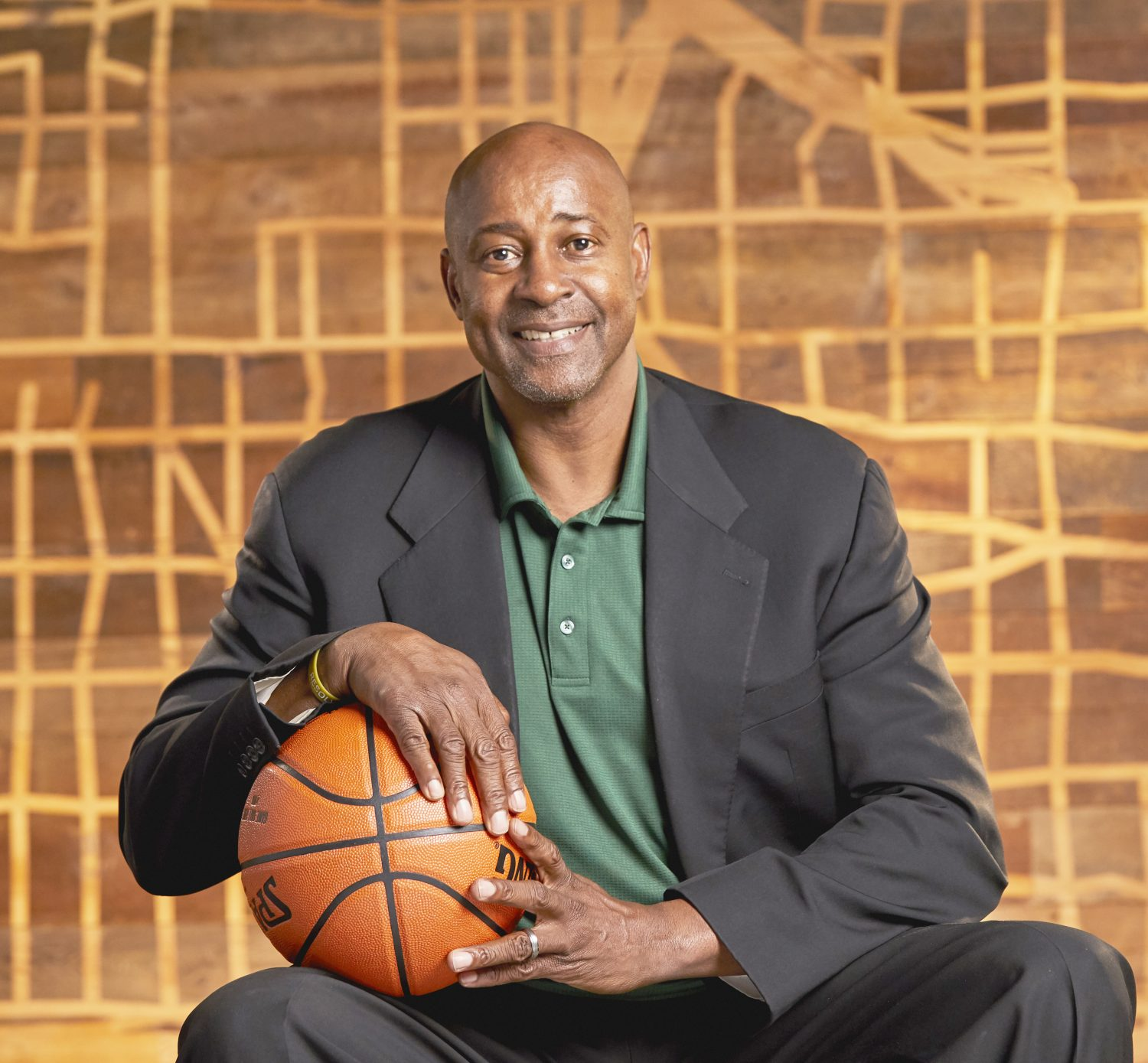 older black male with basketball