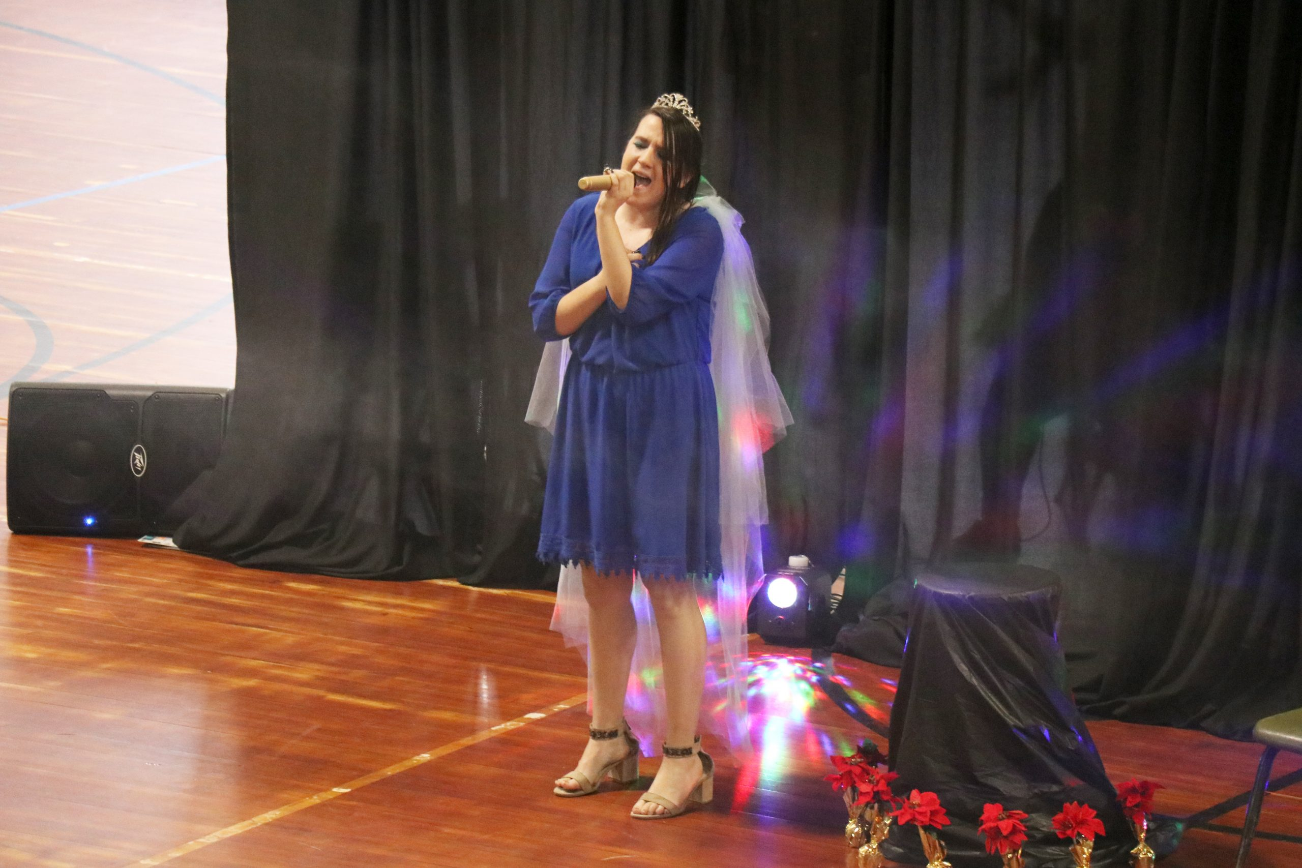 young girl in purple dress singing