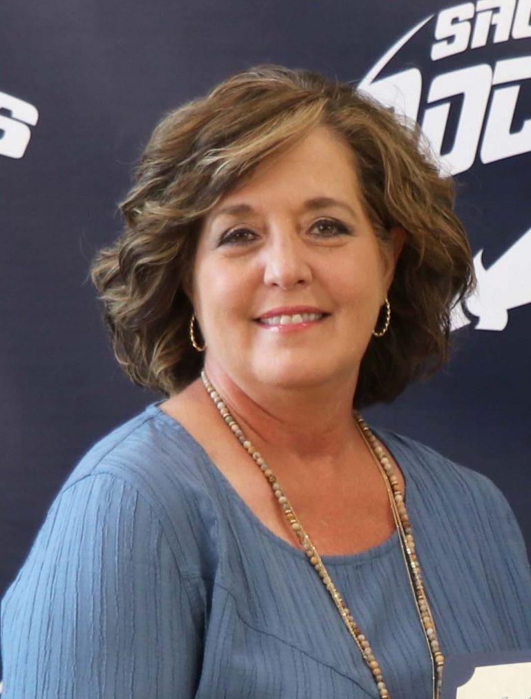 Woman in brown shirt smiling