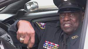 a older man in a police uniform